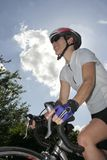 Athletic Female Road Cyclist Stock Images