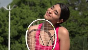 Athletic Female Teenage Tennis Player Daydreaming. A young female hispanic teen stock video