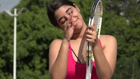 Athletic Female Teenage Tennis Player And Happiness. A young female hispanic teen stock video footage