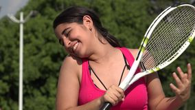 Athletic Female Teenage Tennis Player And Winning. A young female hispanic teen stock video