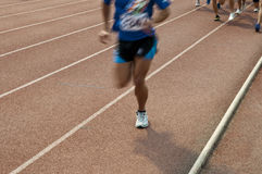 Athletic field athletes Stock Images