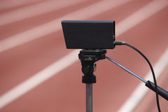 Athletic finish line photoelectric cell control device and runni Stock Image