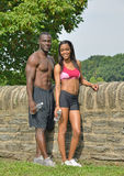 Athletic and fit African American couple - pausing during work-out Royalty Free Stock Photos