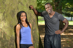 Athletic and fit African American couple - pausing during work-out Stock Image