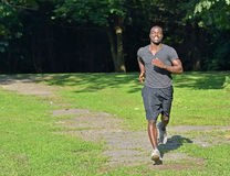 Athletic and fit African American male - jogging in a park Stock Photography