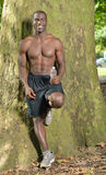 Athletic and fit African American male pausing from work-out Royalty Free Stock Photo