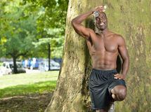 Athletic and fit African American male pausing from work-out Royalty Free Stock Images