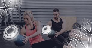 Athletic fit people in gym with triangle interface. Digital composite of Athletic fit people in gym with triangle interface stock photography