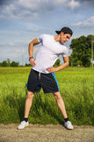 Athletic, fit young man outdoor in country doing Stock Images
