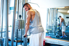 Athletic fitness coach, bodybuilder training at gym, triceps Royalty Free Stock Images