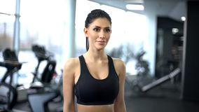 Athletic fitness woman in gym looking at camera, active lifestyle, sport club. Stock photo royalty free stock image