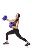 Athletic fitness woman helthy sport isolated white background black clothes with dumbbells Stock Photos
