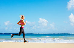 Athletic Fitness Woman Running on the Beach. Female Runner Jogging. Outdoor Workout. Fitness Concept Royalty Free Stock Photo
