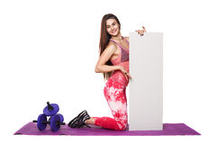 Athletic fitness woman with sign board blank helthy sport isolated white background black clothes yoga poses Stock Photo