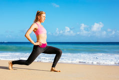 Athletic Fitness Woman Stretching At the Beach, Royalty Free Stock Image