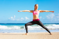 Athletic Fitness Woman Stretching At the Beach, Royalty Free Stock Images
