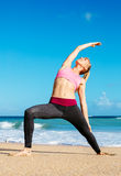 Athletic Fitness Woman Stretching At the Beach, Stock Photos