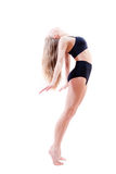 Athletic flexible girl in black suit on white Stock Photo