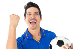 Athletic football player cheering Stock Image