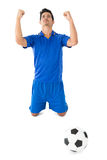 Athletic football player cheering Royalty Free Stock Photo
