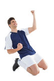 Athletic football player cheering Royalty Free Stock Images