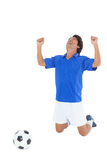 Athletic football player cheering Stock Photo