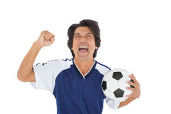 Athletic football player cheering Royalty Free Stock Photos