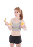 Athletic girl with a banana and juice in hand Royalty Free Stock Image