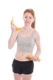 Athletic girl with bananas in hand Royalty Free Stock Photos