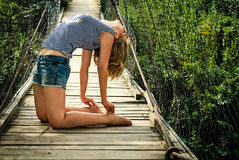 Athletic girl on the bridge Royalty Free Stock Photo