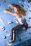 Athletic girl climbing Royalty Free Stock Image