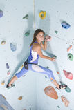 Athletic girl climbing Royalty Free Stock Images