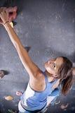 Athletic girl climbing Stock Photo