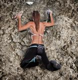 Athletic girl climbing Royalty Free Stock Photography