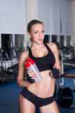 Athletic girl with cocktail bottle Royalty Free Stock Photo