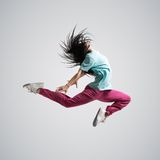 Athletic girl dancing jumping Stock Images