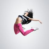 Athletic girl dancing jumping Stock Photography