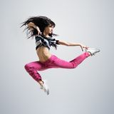 Athletic girl dancing jumping Royalty Free Stock Image