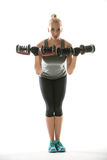 Athletic girl does exercise with dumbbells Stock Images