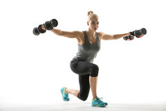 Athletic Girl Does Exercise With Dumbbells Royalty Free Stock Image