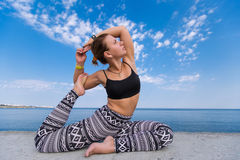 Athletic girl doing exercises outdoors Royalty Free Stock Photo