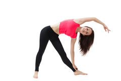 Athletic girl doing hand exercises sitting on the splits stock photos