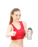 Athletic girl drinks water after exercising isolated in white ba. Ckground Royalty Free Stock Photo