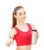 Athletic girl drinks water after exercising isolated in white ba. Ckground Stock Photos