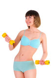 Athletic girl with dumbbells Royalty Free Stock Photo