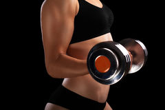 Athletic girl with dumbbells in hand. Stock Images