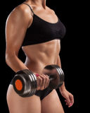 Athletic girl with dumbbells in hand. Stock Image