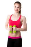 Athletic girl with dumbbells Royalty Free Stock Image