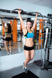Athletic girl engaged in the gym Royalty Free Stock Images