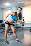Athletic girl engaged in the gym Royalty Free Stock Photo